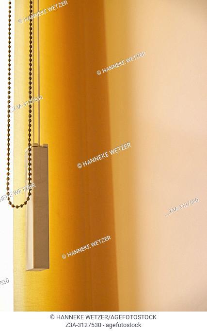 Orange vertical window blinds