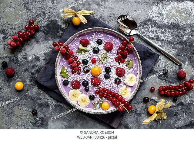 Yogurt with fruits, blueberry, red currants, raspberry, kiwi, banane, physalis