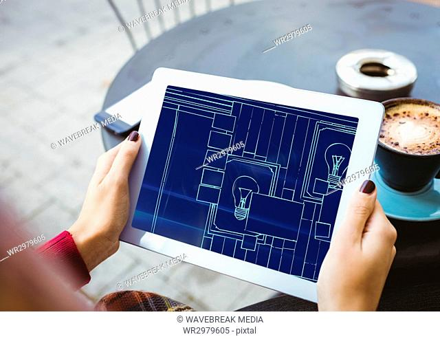 hands with tablet with blueprint on it (two-tone: dark blue and light blue)