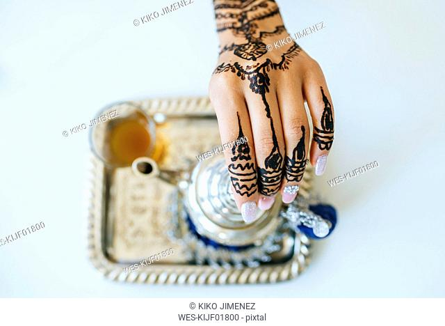 Morocco, woman's hand with henna tattoo, close-up