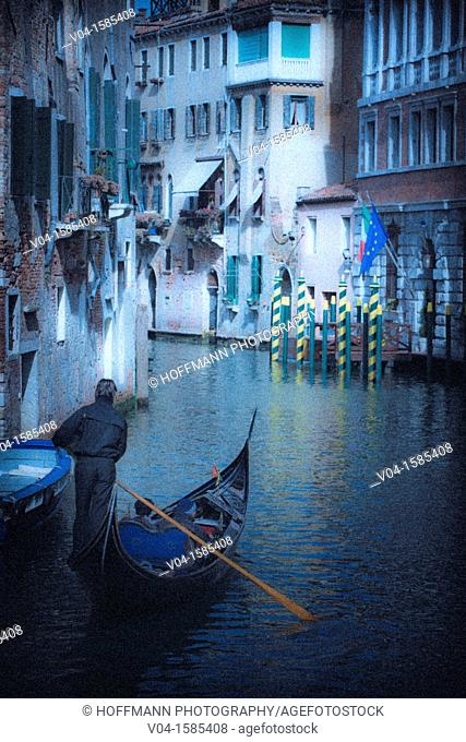 Mystical view of a gondola with gondolier in Venice, Italy, Europe