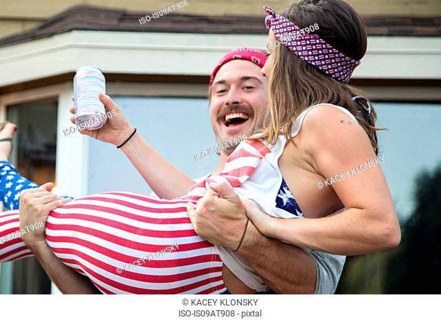 Couple wearing American flag costume celebrating Independence Day, USA