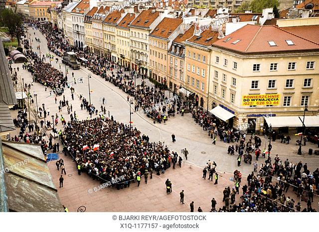 Warsaw Poland: People gather at the Presidential Palace in memory of president Lech Kaczynski who died in a plane crash