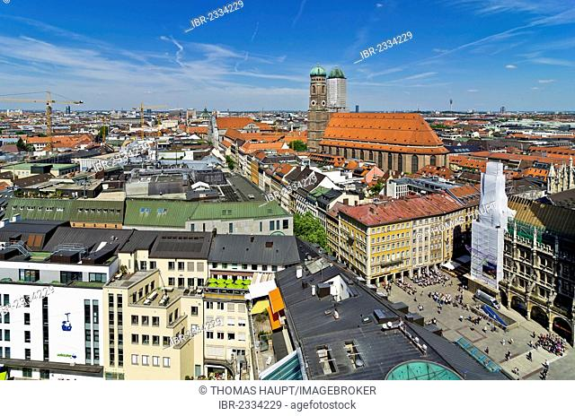 View over the roofs of Munich as seen from the steeple of the Church of St. Peter, Frauenkirche church on the right, Munich, Upper Bavaria, Bavaria, Germany