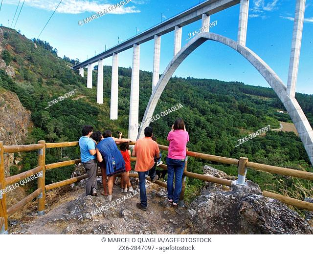 Family watching modern bridge for the high speed AVE train at Gundian viewpoint of Ulla River. Ponte Ulla site at Vedra Council
