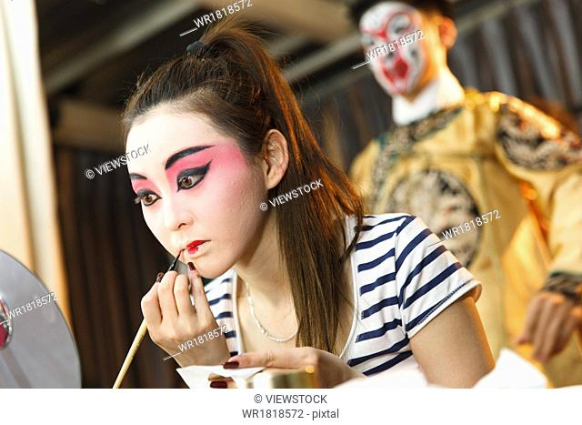 The performer in the dressing room make up