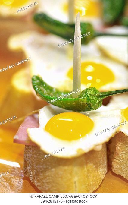 Fried eggs with Green pepper. Pintxos or Tapas. Food very Typical in the Basque country. San Sebastián (Donostia), Gipuzkoa, Basque Country, Spain