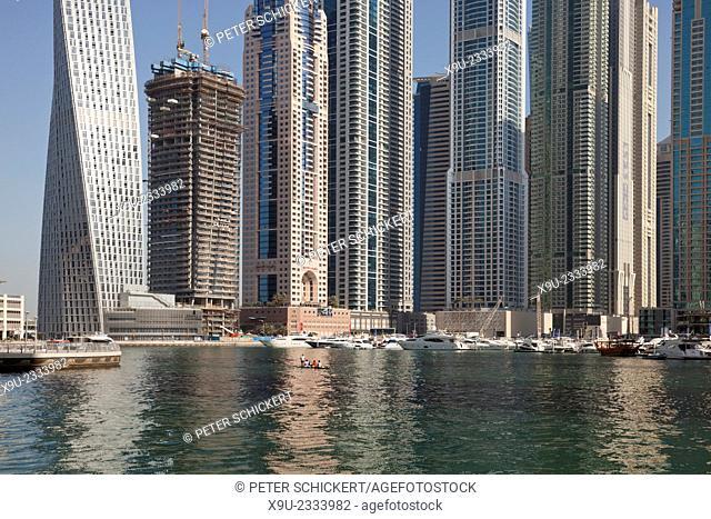 rowing boat and skyscraper of Dubai Marina, Dubai, United Arab Emirates, Asia