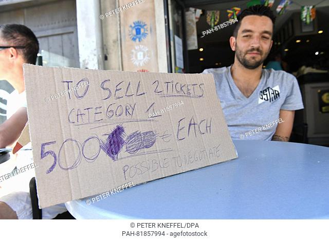 A man holds a sign trying to sell 2 tickets in Marseille, France, 07 July 2016. Germany will face France in a semi final of the UEFA EURO 2016 in Marseille on...