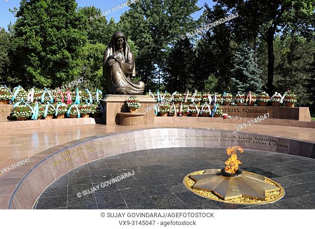 Tashkent, Uzbekistan - May 12, 2017: View of Crying Mother monument and eternal flame at Independence square