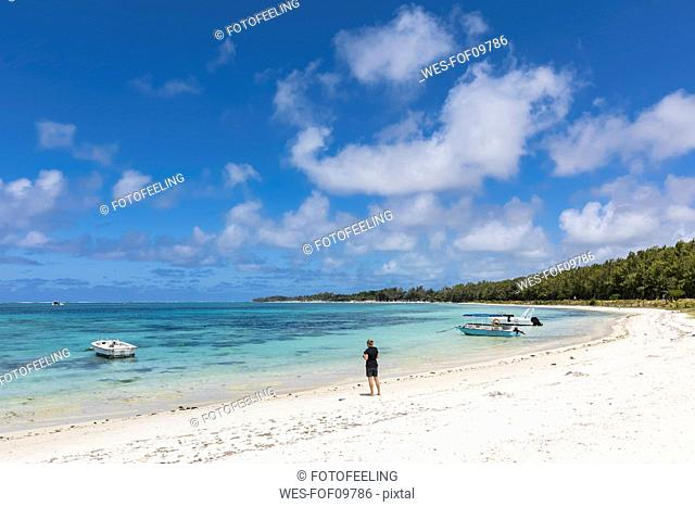 Mauritius, Indian Ocean, Flacq, East Coast, female tourist at beach of Belle Mare
