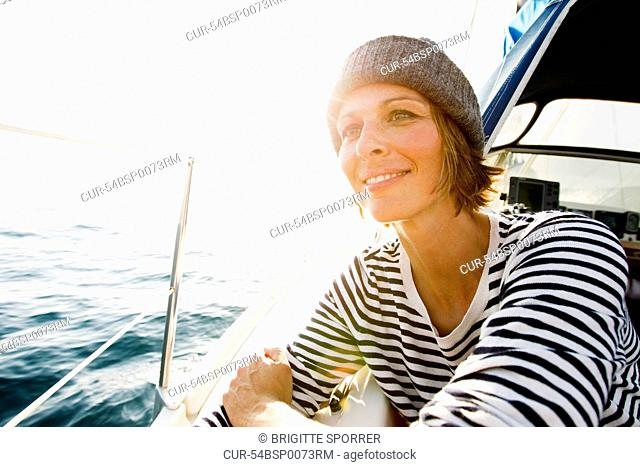 Smiling woman standing on boat