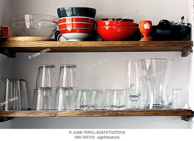 Front view of the shelves of a kitchen