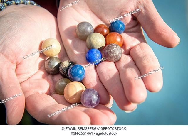 Traditional marbles in a person's hands in Cumberland, Maryland