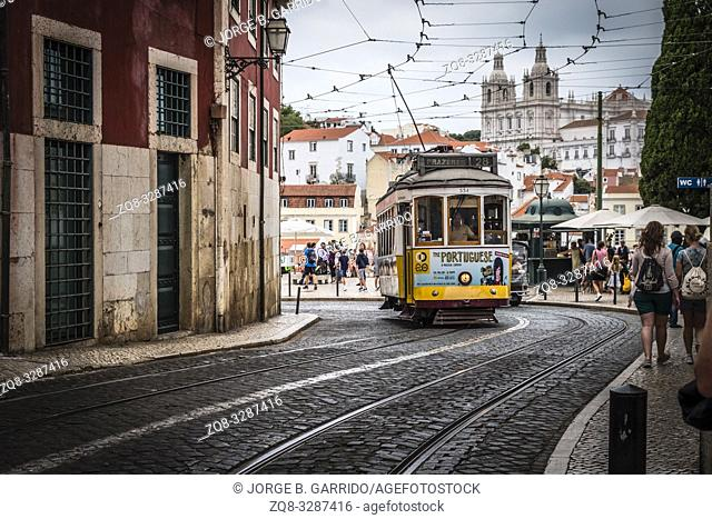 Famous retro yellow tram on the street in Lisbon city, Portugal