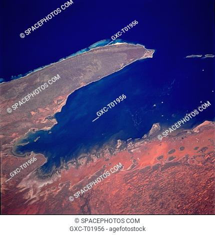 This near-vertical photograph of Exmouth Gulf, an inlet of the Indian Ocean, and the North West Cape Peninsula on the central coast of Western Australia was...