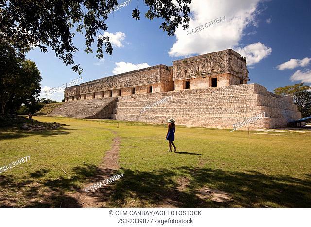 Tourists walking around the Palacio del Gobernador-Governor's Palace, Maya archeological site Uxmal, Yucatan Province, Mexico, Central America
