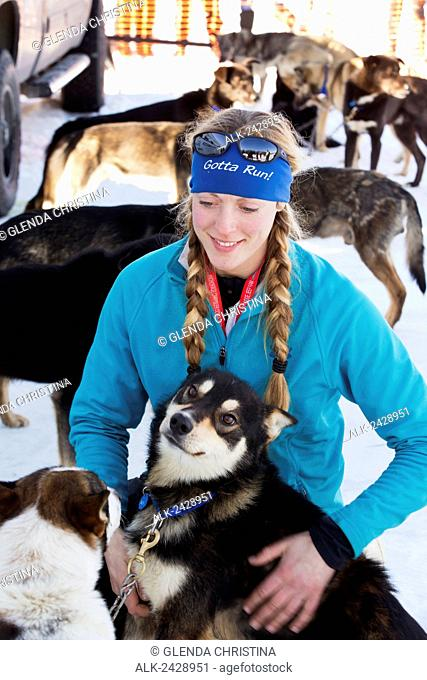 Anna Berington #52 interacting with her dog team before the 2014 iditarod trail dog sled race in Willow Alaska