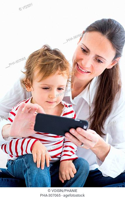 2 year-old boy with cell phone