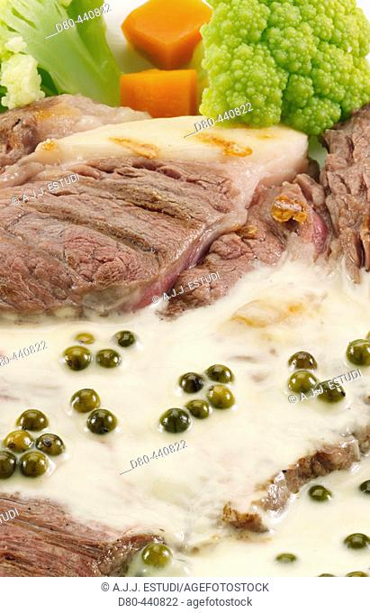 Steak with green pepper sauce, detail