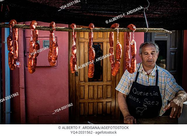 Man selling sausages on the street. Llanes. Asturias. Spain