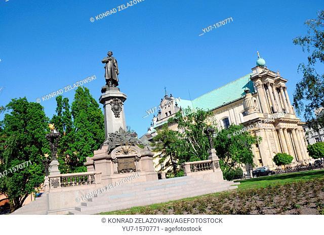 Adam Mickiewicz statue and St Joseph Care church at Krakowskie Przedmiescie Street in Warsaw, Poland