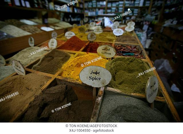 Spices and food for sale at a market in the old city section of Jerusalem