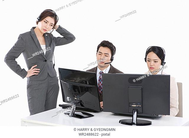 Three stressful business people at work