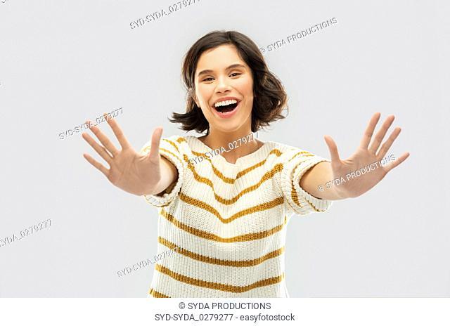 happy woman showing ten fingers of two hands