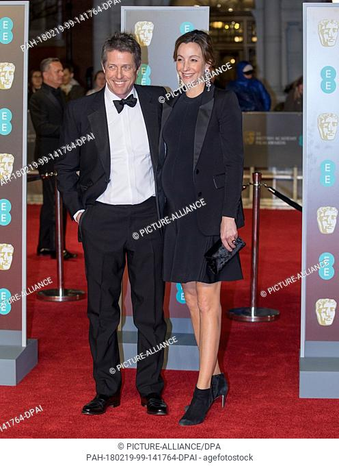 Hugh Grant and Anna Eberstein attend the EE British Academy Film Awards, Bafta Awards, at the Royal Albert Hall in London, England, Great Britain