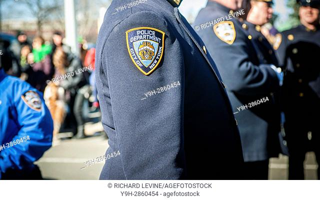 An NYPD patch on an officer's dress uniform in New York