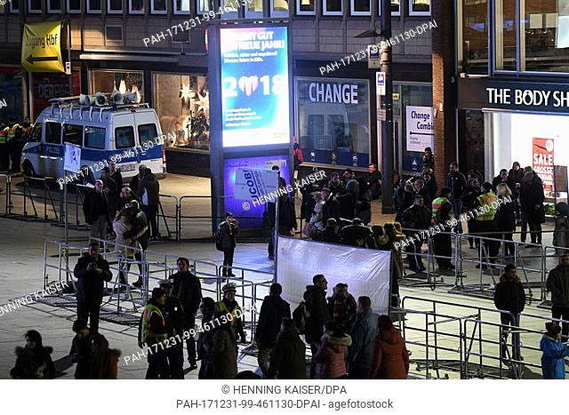 Policemen secure the area around the central train station in Cologne, Germany, 31 December 2017. Great measures of security were taken this year during the...