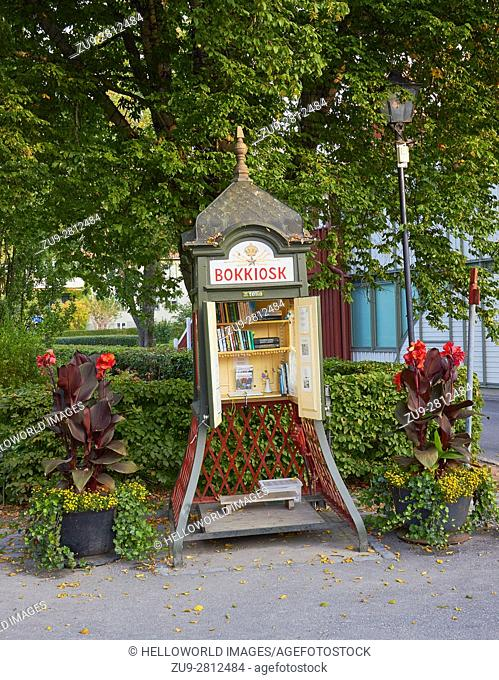 Library book kiosk in an old telephone booth, Sigtuna, Stockholm County, Sweden, Scandinavia