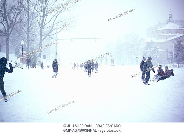 Several students mingle and play on Charles Street covered in snow during a snow day at Johns Hopkins University, Baltimore, Maryland, 2016