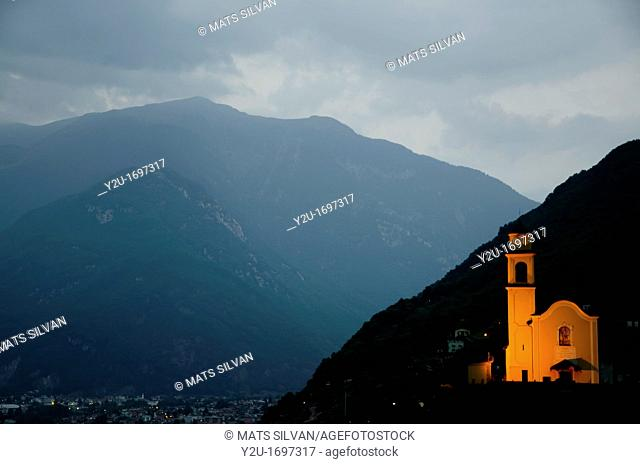 Illuminated church on the mountains at night