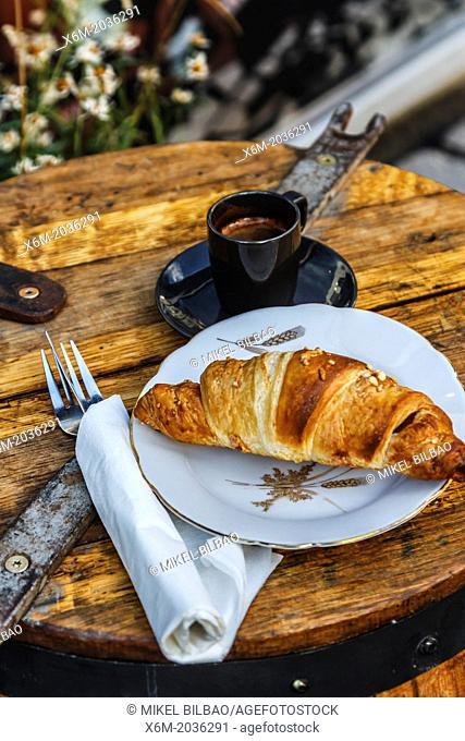 Croissant and coffee. Laugavegur street. Reykjavik. Iceland, Europe