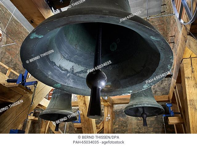 A view of massive church bells hanging from the bell tower of Muenster Cathedral, also known as St. Paulus Dom (Saint Paulus Cathedral), in Muenster, Germany