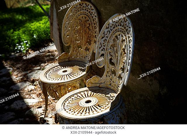 Aged metal chairs