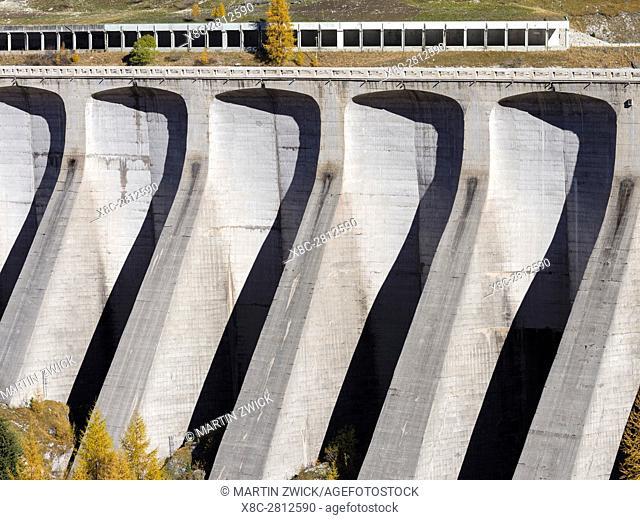 Dam of Lago di Fedaia, a reservoir at Passo Fedaia near Marmolada. Europe, Central Europe, Italy, October