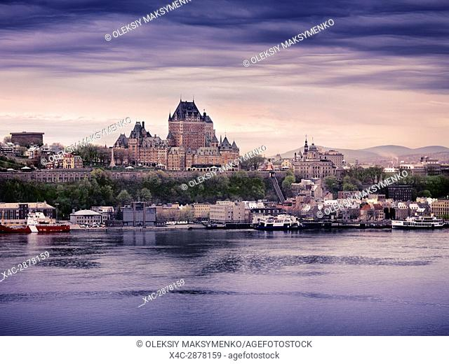 Old Quebec City and port skyline at dusk. Fairmont Le Château Frontenac luxury grand hotel Chateau Frontenac view from across the St