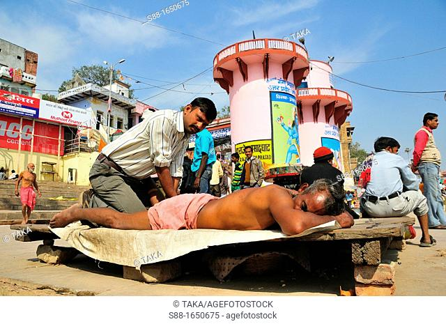 Massage by the Ganges river