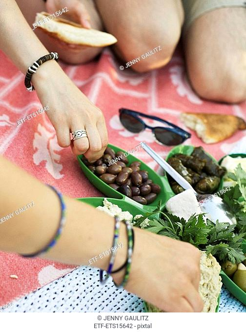 People having a picnic with Arabic food Sweden