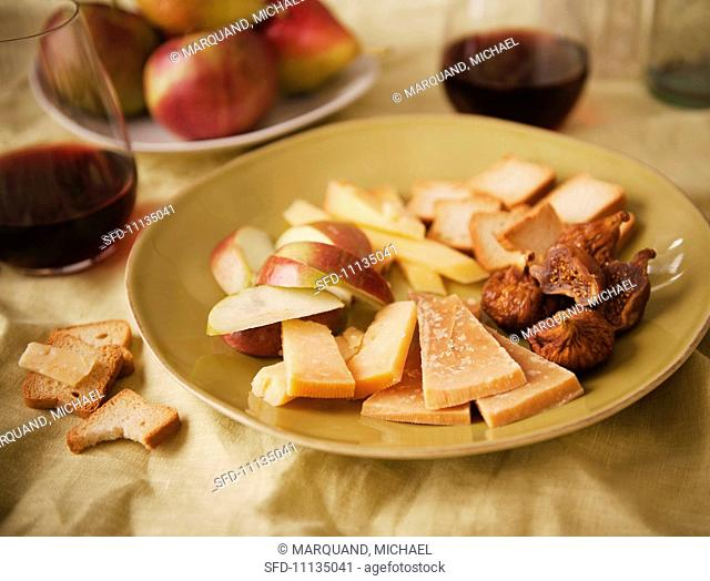 Slices of Aged Gouda, Apple Slices, Figs and Crackers, With Red Wine