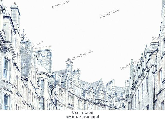 Low angle view of townhouse roofs and chimneys