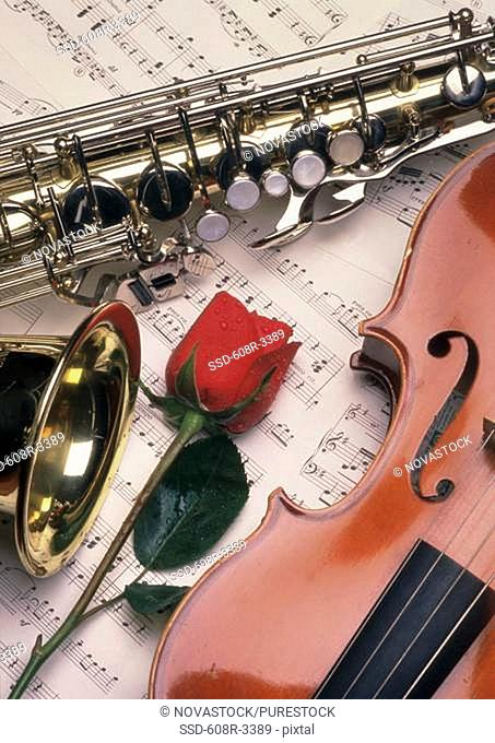 Saxophone and a violin on sheet music