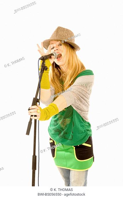 young woman, musician singing into microphone