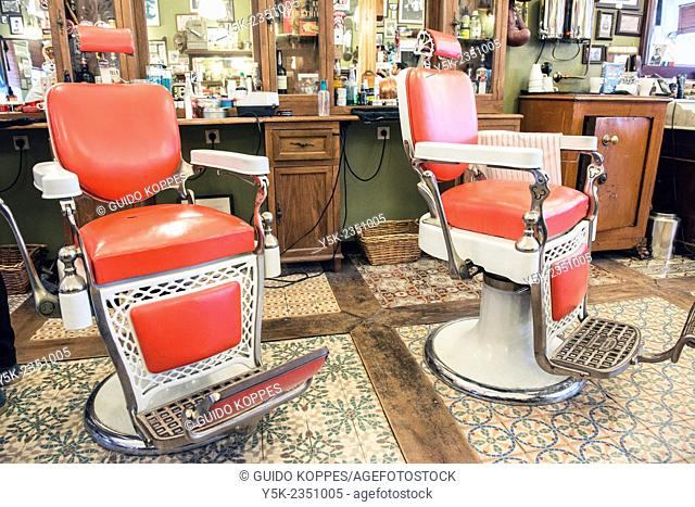 Rotterdam, Netherlands. Old refurbished retro barber chair in Barbershop Schorem