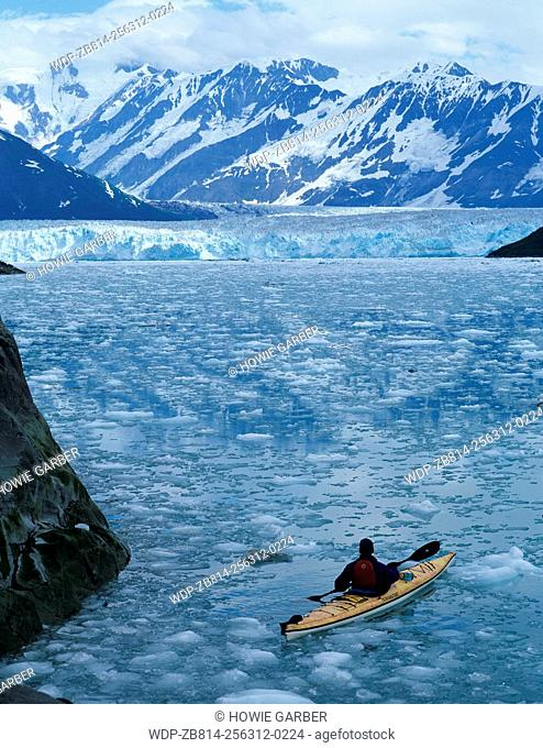 Ehren kayaks through icebergs, Disenchantment Bay, Russell Fjord Wilderness, Wrangell-St. Elias National Park, Alaska