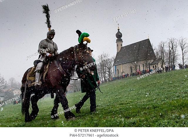 A man dressed as Saint George rides to the so-called 'Ettendorfer Kircherl' (Catholic church of Saint Vitus and Anna, seen in the background) during the...
