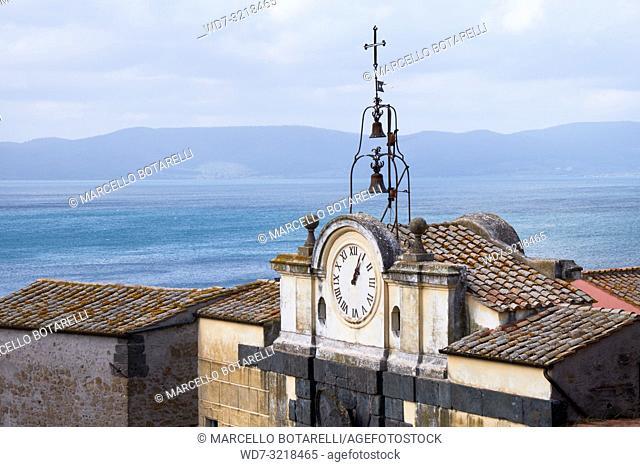 view of Lake Bracciano with ancient clock and bells, Anguillara Sabazia, Lazio, Italy